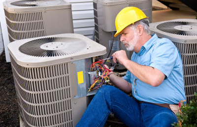 Technician working on an outdoor A/C unit