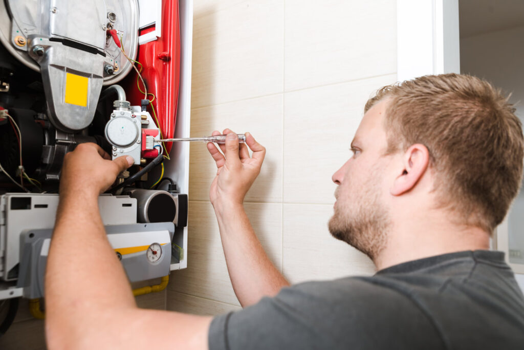 A technician working on a furnace