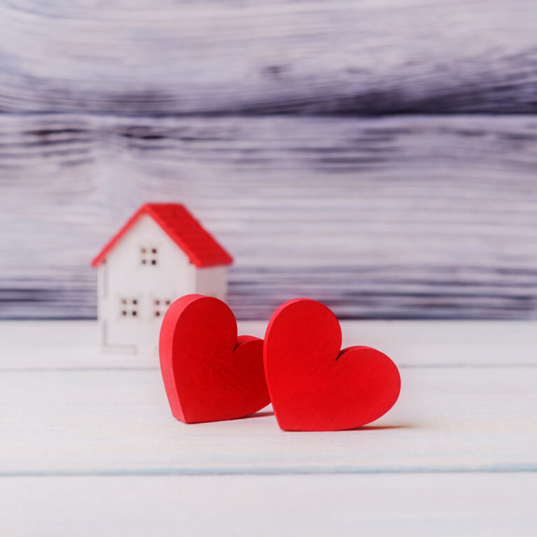 Hearts in front of a house