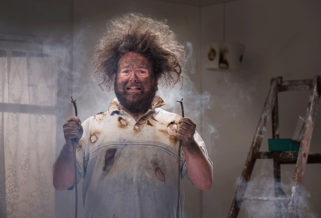 Man with wires and wild hair